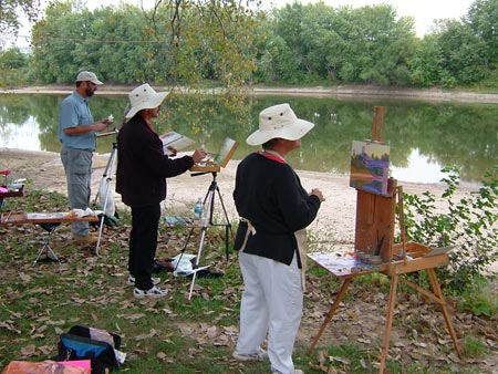 Local artists paint scenery from the banks of the Wabash River.
