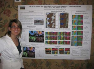 Stephanie Dunten of Lafayette stands beside the poster she presented at Valparaiso University's 7th Annual Great Lakes Meteorology Conference on March 28, 2009.