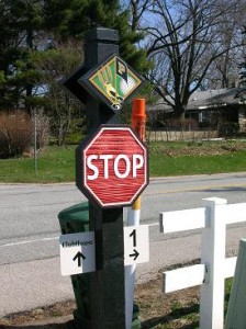 The stop signs taken from the Birck Boilermaker Golf complex and the Ackerman course on the Purdue campus resemble these custom-made wooden signs.