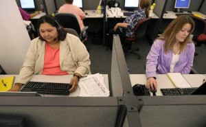Alorica customer service representatives take calls in the Topeka, KS call center. (Photo courtesy Topeka Capitol-Journal)