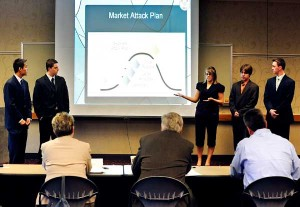 Team members Si Yi Huang of Greenwood, Mathew Altepeter of Lafayette, Josie Gandy of Frankfort, Kyle Yoder of Indianapolis and Jake Pusateri of Fishers present their business plan for the company 'Compact Disk Diagnostics LLC' before judges during the Purdue Research Park Entrepreneurship Academy. Judges facing the students are from left: Jody Hamilton of Greater Lafayette Commerce, Gail Koehler of PEFCU, Dave Shelby of ICx Griffin Analytical Technologies Inc. and Brad Addison of Barnes & Thornburg LLP. (Andrew Hancock/Purdue Marketing and Media)