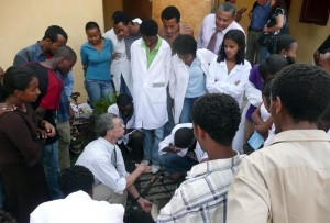 Mark Hilton, Purdue veterinarian and clinical professor of food and animal production medicine, explains to veterinary students in Ethiopia how to properly trim cow hooves. (Purdue University photo courtesy of Mimi Arighi)
