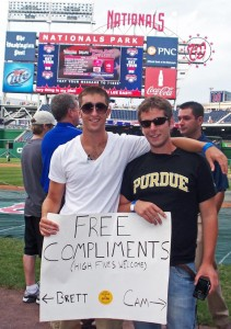 The Purdue Compliment Guys, Brett Westcott (left) and Cameron Brown, traveled this summer from New Orleans to New York on their Kodak-sponsored BrightSide Tour, delivering compliments wherever they stopped, including a Major League Baseball game in Washington, D.C. (Photo courtesy of Kodak)