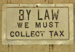 Sign - By Law, We must collect sales tax
